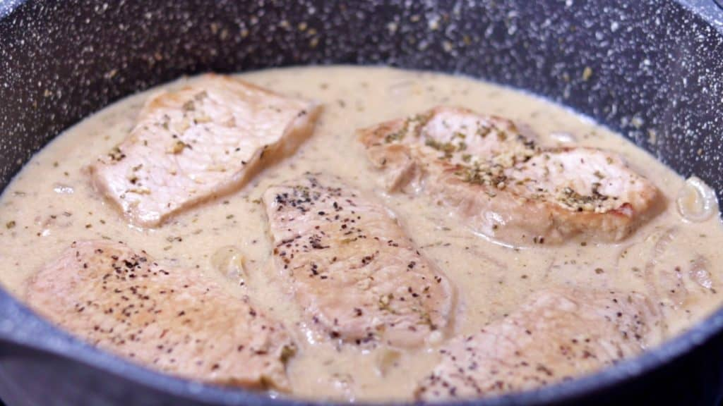 Keto Smothered Pork Chops Simmering